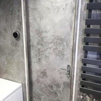 Creative plaster applicator @steveearl27 has matched this client's door with the rest of their Viero Hydro concrete surfaces for a sleek finish on the fixtures and fittings. Not just for walls! #viero #vierouk #italianwallfinishes #polishedplaster #texturedplaster #decorativeplaster #venetianplaster #concreteeffect #concreteinteriors #luxuryinteriors #interiordesign #surfacedesign #bathroomdesign #bathroomideas #bathroomdecor #greyinteriors #applicator #plasterapplicator #hydro